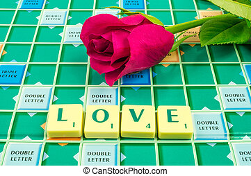 Love Scrabble - The word love on a scrabble board with a red...