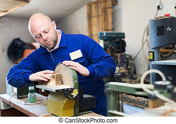 craftsman working with unfinished guitar - Portrait man...