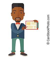 Handsome black guy holding clipboard. - A handsome black guy...