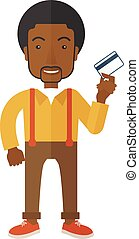 Happy businessman standing holding credit card - A happy...