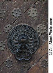 bell on middle ages house - details of middle ages door