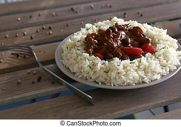 chilli con carne with rice on plate with fork