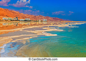 Lowering the water level in the Dead Sea Evaporated salt out...