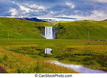 The huge falls Skogafoss - The huge deep falls Skogafoss are...