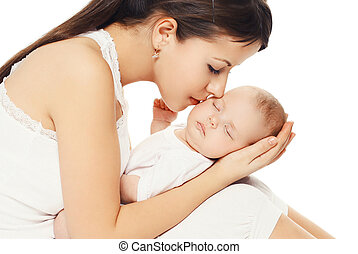 Portrait of young loving mother kissing her baby