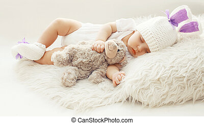 Baby comfort! Sweet infant at home sleeping with teddy bear...