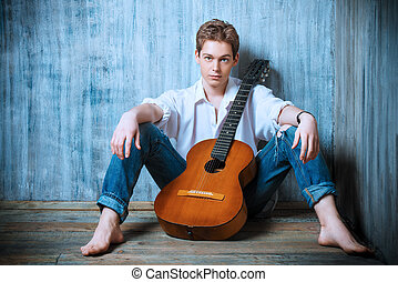 bard singer - Romantic young man playing an acoustic guitar,...