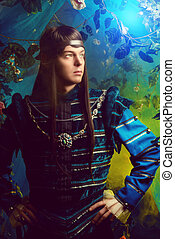 fairytale - Beautiful male elf in the magic forest. Fantasy....