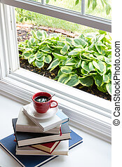 Coffee on Top of Piled Books at the Window