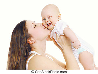 Happiness mother! Young mom kissing her cute baby