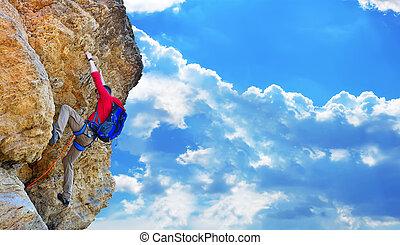 climber climbing up - rock climber with backpack climbing up...