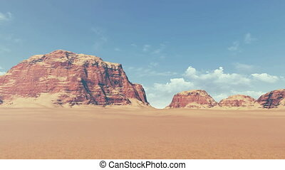 Panorama of red rock formations among barren lands, covered...