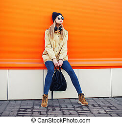 Outdoor fashion portrait of stylish hipster cool girl...
