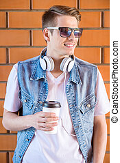 Man outdoors - Handsome young man in smart casual wear...