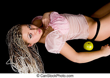 Portrait girl with apple on black background