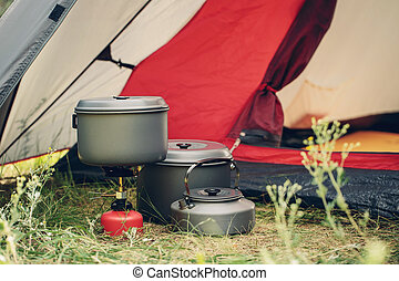 boiling water in kettle on portable camping stove - boiling...
