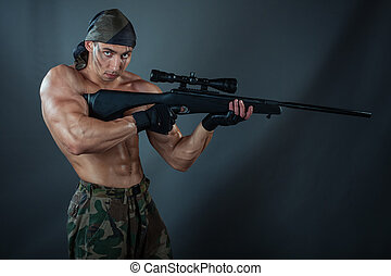 Man sniper - A man holding a rifle Rifle with a telescopic...