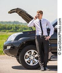 Broken car - Young man having trouble with his broken car,...