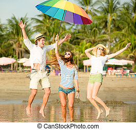 Group of happy young people having fun on the beach - Group...