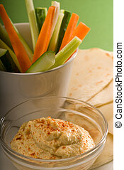 hummus dip with pita bread and vegetable - middle eastern...