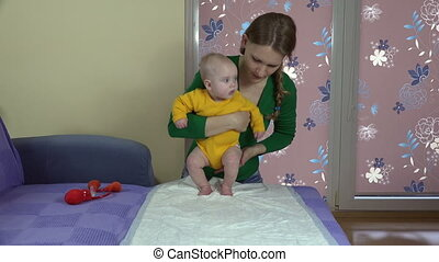 mom exercise baby - Tender mom woman with her infant baby...