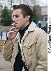 Smoking young guy - Young adult man smoking a cigarette...