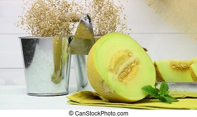 Honeydew melon - Juicy honeydew melon on a wooden table...