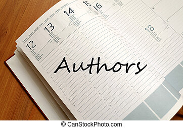 Authors Concept - Business Notepad on wooden table Authors...
