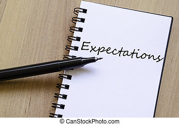 Expectations concept - White notepad and ink pen on the...