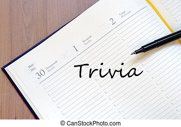 Trivia concept - Yellow blank notepad on office wooden table...
