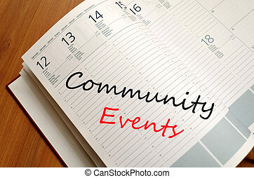 Community events concept - Business Notepad on wooden table...