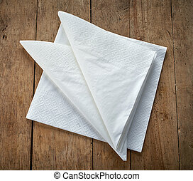 paper napkins - white paper napkins on wooden table