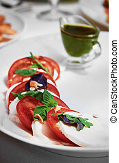 Tomatoes with green sauce - Photo of tomatoes with cheese...