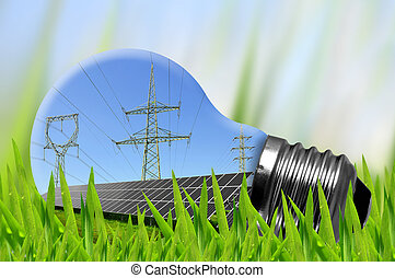 Eco Light bulb - Solar panels and high voltage pylons in...