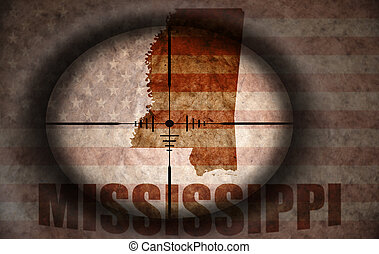 sniper scope aimed at the vintage american flag and...