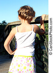 little fashionable girl with beautiful modern coiffure -...