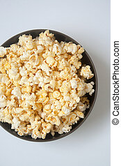 Popcorn for movie tonight - A large bowl of popcorn with...