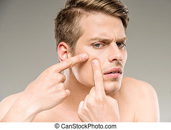 Beauty man - Handsome man touching his face. Squeezing...