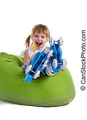 Little girl in roller skates on the chair