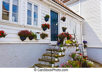 Old centre of Stavanger - Norway - Street with white wooden...