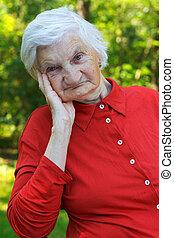 Elderly care - Beautiful wrinkled elderly woman relaxing in...
