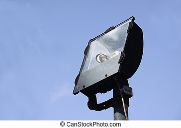 flood light - an unlit flood light used to illuminate a...