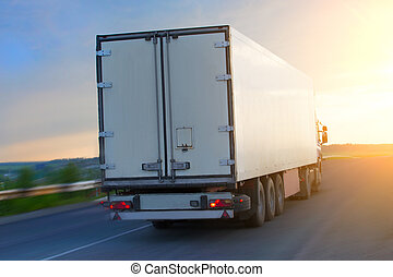 truck moves on highway at sunrise - big truck moves on...
