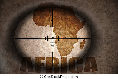 sniper scope aimed at the vintage africa map