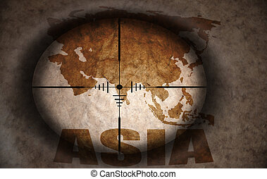 sniper scope aimed at the vintage asia map
