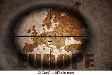 sniper scope aimed at the vintage europe map