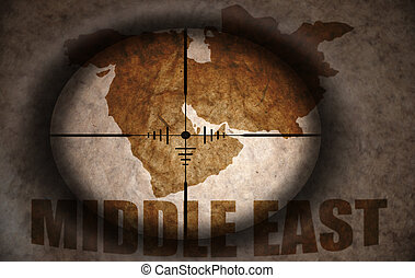 sniper scope aimed at the vintage middle east map