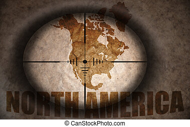 sniper scope aimed at the vintage north america map