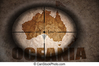 sniper scope aimed at the vintage oceania map