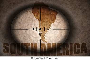 sniper scope aimed at the vintage south america map